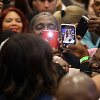 "First Lady Michelle Obama poses with Charlie Crist  supporters after she appeared at his grassroots ""Commit to Vote"" rally. The campaign called on the event to "" energize voters and lay out the stakes for Floridians in the critical election on November 4th."" at the Barnett Park Gymnasium in Orlando, Florida on Friday, Nov. 17, 2014. (AP Photo/Alex Menendez)"