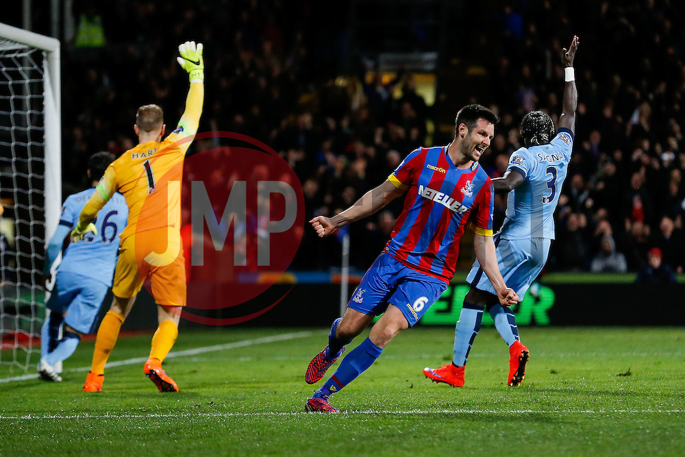 Scott Dann of Crystal Palace celebrates after nutmegging Joe Hart of Manchester City to provide the assist for Glenn Murray (not pictured) to score a goal and make it 1-0 - Photo mandatory by-line: Rogan Thomson/JMP - 07966 386802 - 06/04/2015 - SPORT - FOOTBALL - London, England - Selhurst Park - Crystal Palace v Manchester City - Barclays Premier League.