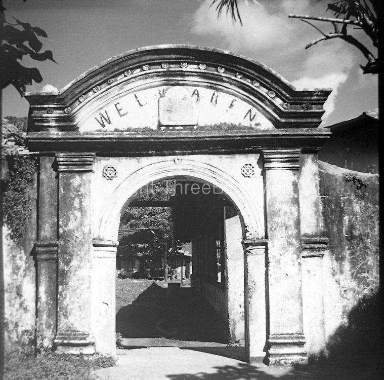 Entry arch of the Dutch colonial Welvaren nutmeg plantation. Indonesia.