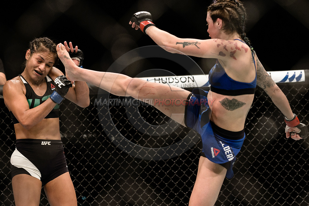 "GLASGOW, UNITED KINGDOM, JULY 16, 2017: Cynthia Calvillo (black/white trunks) versus Joanne Calderwood (blue/black skort) during ""UFC Fight Night Glasgow: Nelson vs. Ponzinibbio"" inside the SSE Hydro Arena in Glasgow, Scotland on Sunday, July 16, 2017."