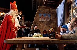 01.12.2016, Riedlhof, Lienz, AUT, Osttiroler Krampustage im Bild ein Mann als Heiliger Nikolaus verkleidet beim traditionellen Osttiroler Tischziachn // Members of the Krampusgroup NIKRAMO during the traditional Osttiroler table drawing. Krampus a mythical creature that, according to legend, accompanies Saint Nicholas during the festive season. Instead of giving gifts to good children, he punishes the bad ones, Lienz, Austria on 2016/12/01. EXPA Pictures © 2016, PhotoCredit: EXPA/ JFK