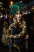 New York, NY - 31 October 2016. A woman costumed as Medusa, complete wit a snake,  in the Greenwich Village Halloween Parade.
