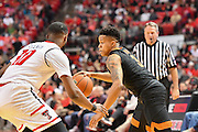 LUBBOCK, TX - MARCH 1: Jacob Young #3 of the Texas Longhorns dribbles around Niem Stevenson #10 of the Texas Tech Red Raiders during the game on March 1, 2017 at United Supermarkets Arena in Lubbock, Texas. Texas Tech defeated Texas 67-57. (Photo by John Weast/Getty Images) *** Local Caption *** Jacob Young;Niem Stevenson