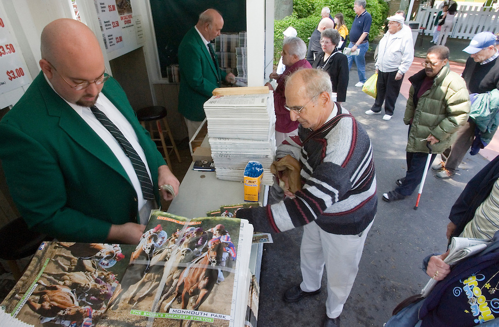 (PPAGE1) Oceanport 5/14/2005 Carmine Abbondanzo of Morristown purchases a Monmouth Park Program from Jeff Madonna of Howell (left)   Michael J. Treola Staff Photographer....MJT
