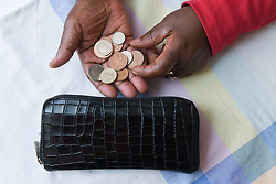 Older woman counting money from her purse,