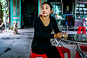 LONG PHU, VIETNAM  – DECEMBER 18, 2017: A portrait of Thai Thi Thanh Thuy, 40, proprietress of a restaurant adjacent to the construction grounds of the Long Phu 1 power plant.