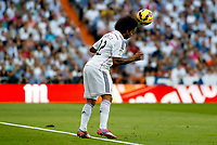 """Spanish  League""- match Real Madrid Vs FC Barcelona- season 2014-15 - Santiago Bernabeu Stadium - Marcelo (Real Madrid) controls the ball during the Spanish League match against FC Barcelona(Photo: Guillermo Martinez / Bohza Press / Alter Photos)"