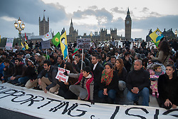 Westminster, October 9th 2014. Protesters hold a sit-in on Westminster Bridge in London as scores of Kurds demonstrate against ISIS and demand that the UK and Turkey assist them in defending themselves against the Jihadist movement.