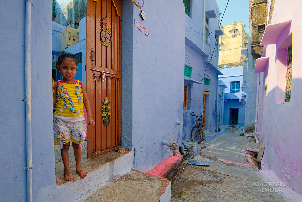 Curious little girl outside her house, at Bundi old old town