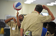 Boy Scout Troop 772's Calvin Minion spins a basketball during a meeting at Dan McCarty Middle School in Fort Pierce on Feb. 12, 2014.