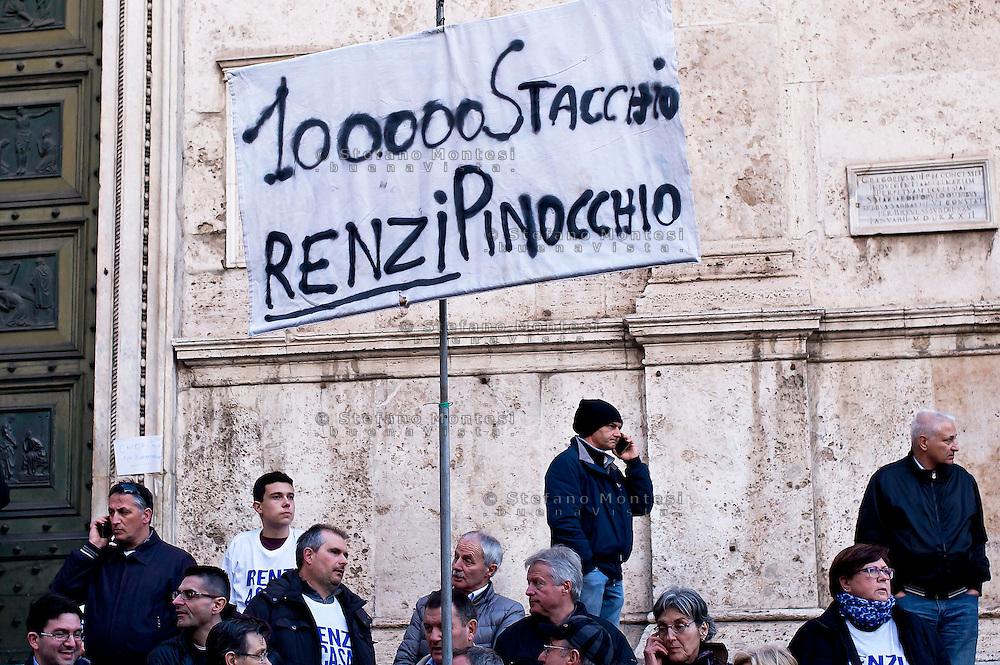 Roma 28 Febbraio 2015<br /> &quot;Renzi a casa!' - Manifestazione della Lega Nord in piazza del Popolo contro il Governo Renzi, e  contro l'Euro. Il popolo della Lega Nord, Un cartello a favore di Stacchio,il benzinaio che ha ucciso un rapinatore durante una rapina.<br /> Rome February 28, 2015<br /> &quot;Renzi at home! '- Demonstration of the Northern League in Piazza del Popolo against the government Renzi, and against the Euro. The people of the Northern League, A sign in favor of Stacchio, the gas station of Nanto, which killed a robber during a robbery