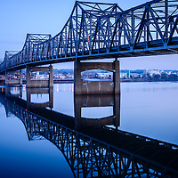 Picture of Murray Baker Bridge in Peoria Illinois. The Murray Baker Bridge spans the Illinois River connecting Peoria with East Peoria as Interstate I-74. Built in 1958, the bridge is named after Murray Baker who started a company that would later become Caterpillar.