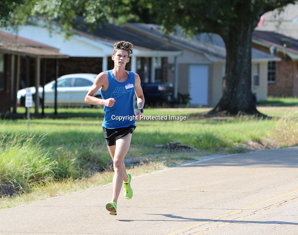 LIBBY EZELL | BUY AT PHOTOS.DJOURNAL.COM<br /> Josh Reed, 18 finished first in the Jackson's 5k Saturday in Verona