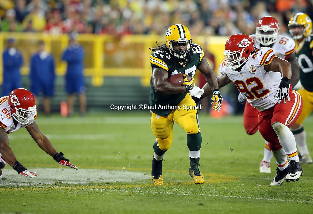 Green Bay Packers running back Eddie Lacy (27) catches a pass and runs with the ball in the second quarter while being chased by Kansas City Chiefs nose tackle Dontari Poe (92) during the 2015 NFL week 3 regular season football game against the Kansas City Chiefs on Monday, Sept. 28, 2015 in Green Bay, Wis. The Packers won the game 38-28. (©Paul Anthony Spinelli)