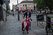 Heading home after the Clare Ball with girl in a shopping trolley, Cambridge College May Balls. Cambridge, England. 14 June 2016