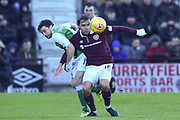 16 Lewis Stevenson battles with 16 Connor Randall  during the William Hill Scottish Cup 4th round match between Heart of Midlothian and Hibernian at Tynecastle Stadium, Gorgie, Scotland on 21 January 2018. Photo by Kevin Murray.