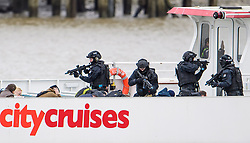 © Licensed to London News Pictures. 19/03/2017. London, UK. Anti-terror Police stand over hostages as they board a tourist boat, taken hostage by people playing armed terrorists, in an ant-terror training exercise takes place on The River Thames in  London. It is the first time that an exercise of this type has taken place on the river. Photo credit: Ben Cawthra/LNP