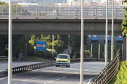 © Licensed to London News Pictures. 17/07/2020. London, UK. An ambulance parked under a bridge on the A102  Blackwall Tunnel southern approach. Police negotiators are speaking to a man who is sitting on a ledge on a bridge over the road. Police have blocked the A102 and have cordoned off the bridge this has caused major traffic disruption in the area.  Photo credit: George Cracknell Wright/LNP