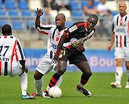 23-08-2008 VOETBAL:WILLEM II:RAYO VALLECANO:TILBURG<br /> Ibrahim Kargbo verdedigt M. Diame<br /> Foto: Geert van Erven