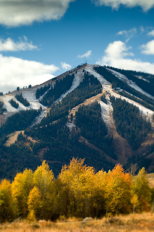 Idaho. Sun Valley. Ketchum. Fall colors and Mt. Baldy / Bald Mountain with light snow with artistic blurred vignette.