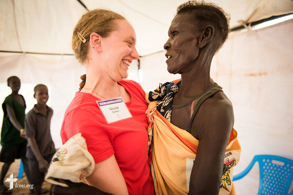 Nicole Boeder, a teacher and a member of Trinity Lutheran Church, Springfield, Ill., receives a hug from a joyful patient during the LCMS Mercy Medical Team on Tuesday, June 21, 2016, in Nataparkakono, a village in Turkana, Kenya.  LCMS Communications/Erik M. Lunsford
