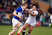 French player Manager Romane try to apply a stiff arm to an English defender in the first half during the Women's 6 Nations match between England Women and France Women at the Keepmoat Stadium, Doncaster, England on 10 February 2019.