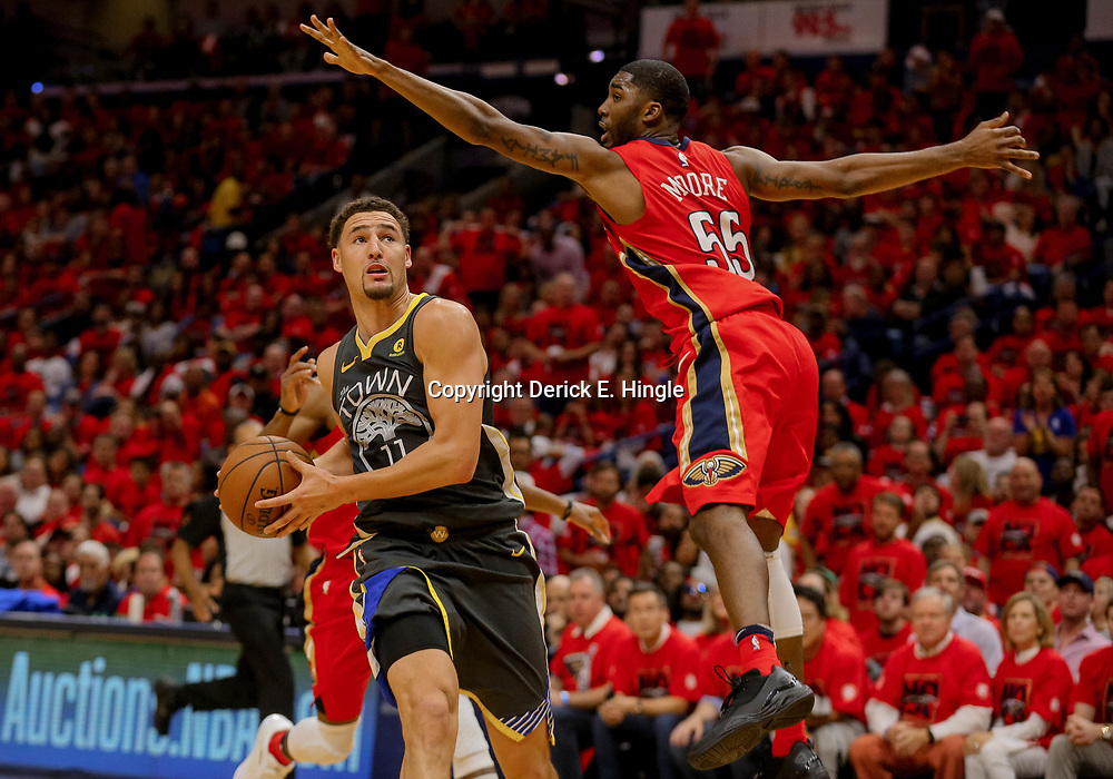 May 4, 2018; New Orleans, LA, USA; Golden State Warriors guard Klay Thompson (11) drives past New Orleans Pelicans forward E'Twaun Moore (55) during the second quarter in game three of the second round of the 2018 NBA Playoffs at Smoothie King Center. Mandatory Credit: Derick E. Hingle-USA TODAY Sports
