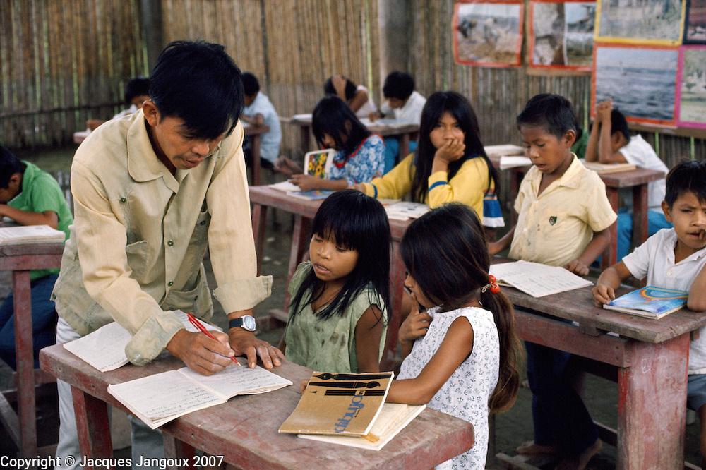 School in Shipibo village on shores of Ucayali River, Peru. Shipibo language belongs to the Panoan family.