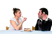 Man and Woman in casual clothes eats cream cake