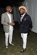 August 25, 2012-Brooklyn, NY: Recording Artist Yasiin Bey aka Mos Def and Recording Artist Rashad Smith backstage at the Afropunk Festival 2012 held in Brooklyn, NY on August 25, 2012. The Afropunk Festival has become a Brooklyn intuition, the focal point for the burgeoning Afro-punk movement. Over the past seven years, the festival has presented new artists before they hit it big, such as Grammy-nominated Santigold, The Noisettes and Janelle Monae. Afro-punk mainstays like Saul Williams, The Dirtbombs, and Dallas Austin have also graced Afro-punk's stages. (Terrence Jennings/TerrenceJennings.com)