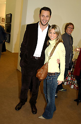 Pop singer RACHEL STEVENS and GAVIN DEAN at a private view of the 2004 Frieze Art Fair - a major exhibition attended by most of the leading contempoary art dealers held in Regents Park, London on 14th October 2004.NON EXCLUSIVE - WORLD RIGHTS