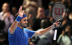 Roger Federer celebrates winning his men's singles match during day five of the Nitto ATP Finals at The O2 Arena, London.