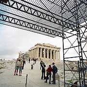"The ancient Parthenon (circa 400 BC, the largest Doric temple ever built) sits on Acropolis hill surrounded by global tourists and scaffolding. Here the modern world's philosophy was born, once the centre of classical Greek culture which the world has inherited for its laws and forward-thinking. Mounted above the Athenian city within fortified 60m high walls, its history is a World Heritage Site, important because of its ""universal symbols of the classical spirit and civilization and form the greatest architectural and artistic complex."" The establishment of democracy, took a leading position amongst the other city-states of the ancient world."