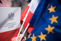 May 6, 2018 - Krakow, Poland - A woman holds a Polish constitution, an European and Polish flag during the Festival of Europe, ahead of Europe's day in Krakow. (Credit Image: © Omar Marques/SOPA Images via ZUMA Wire)