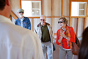 Carole Fried, right, shares stories from her childhood of living and working on the historic apricot farm with her husband Arnold Fried, center, neighbor Kraig Bunnell, and other Cuciz family during the Alviso Adobe Park opening ceremony at Alviso Adobe Park in Milpitas, California, on March 16, 2013. (Stan Olszewski/SOSKIphoto)