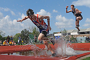 ANDREW JANSEN/JOURNAL<br /> Ian Docherty, Clayton, finished 1st in the 2,000 meter Steeplechase during the Gateway Invitational at Washington University. Peter Rackers, SLUH, finished 2nd.
