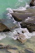 Egret fishing on the rocks.