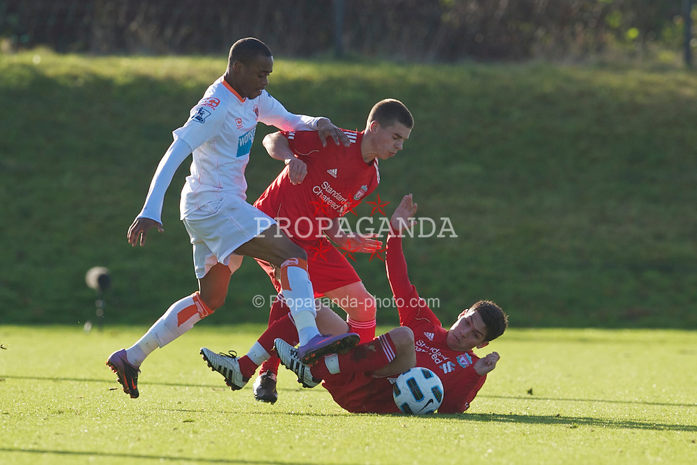 KIRKBY, ENGLAND - Tuesday, November 16, 2010: Liverpool's John Flanagan and Dani Pacheco in action against Blackpool during the FA Premiership Reserves League (Northern Division) match at the Kirkby Academy. (Pic by: David Rawcliffe/Propaganda)