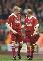 LIVERPOOL, ENGLAND - Thursday, May 14, 2009: Liverpool Legends' player/manager Kenny Dalglish shanks hands with Steve Staunton during the Hillsborough Memorial Charity Game at Anfield. (Photo by David Rawcliffe/Propaganda)