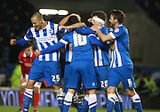 Brighton striker Tomer Hemed is mobbed after scoring the winning goal during the Sky Bet Championship match between Brighton and Hove Albion and Charlton Athletic at the American Express Community Stadium, Brighton and Hove, England on 5 December 2015. Photo by Bennett Dean.