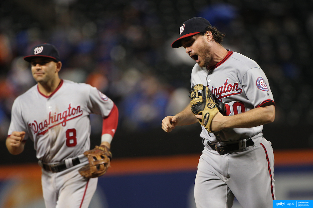 NEW YORK, NEW YORK - July 08: Daniel Murphy #20 of the Washington Nationals celebrates the third out of the inning as he leaves the field with Danny Espinosa #8 of the Washington Nationals during the Washington Nationals Vs New York Mets regular season MLB game at Citi Field on July 08, 2016 in New York City. (Photo by Tim Clayton/Corbis via Getty Images)