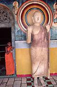 02 Apr 1996, Anuradhapura, Sri Lanka --- Buddhist Monk at Stupa --- Image by © Jeremy Horner/CORBIS