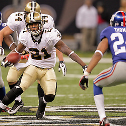 2009 October 18: New Orleans Saints running back Mike Bell (21) runs as New York Giants cornerback Terrell Thomas (24) pursues during a 48-27 win by the New Orleans Saints over the New York Giants at the Louisiana Superdome in New Orleans, Louisiana.
