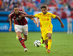 CHARLOTTE, USA - Saturday, August 2, 2014: Liverpool's Jordon Ibe in action against AC Milan's Adil Rami during the International Champions Cup Group B match at the Bank of America Stadium on day thirteen of the club's USA Tour. (Pic by David Rawcliffe/Propaganda)