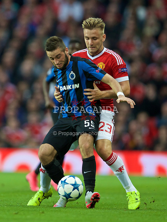 MANCHESTER, ENGLAND - Tuesday, August 18, 2015: Manchester United's Luke Shaw in action against Club Brugge's Tuur Dierckx during the UEFA Champions League Play-Off Round 1st Leg match at Old Trafford. (Pic by David Rawcliffe/Propaganda)