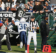 OAKLAND, CA - DECEMBER 19:  Wide receiver Jerry Porter #84 (caught 8 passes for 148 yards and 3 touchdowns) of the Oakland Raiders catches an 18 yard pass for a touchdown and a 21-14 Raiders lead in the 2nd quarter while defended by cornerback Michael Waddell #36 of the Tennessee Titans at Network Associates Coliseum on December 19, 2004 in Oakland, California. The Raiders defeated the Titans 40-35. ©Paul Anthony Spinelli *** Local Caption *** Jerry Porter;Michael Waddell