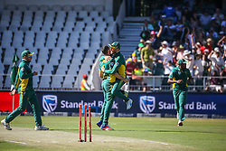 Wayne Parnell of SA celebrates a wicket with Faf du Plessis and other team mates during the 2nd ODI match between South Africa and Australia held at The Wanderers Stadium in Johannesburg, Gauteng, South Africa on the 2nd October  2016<br /> <br /> Photo by Dominic Barnardt/ RealTime Images