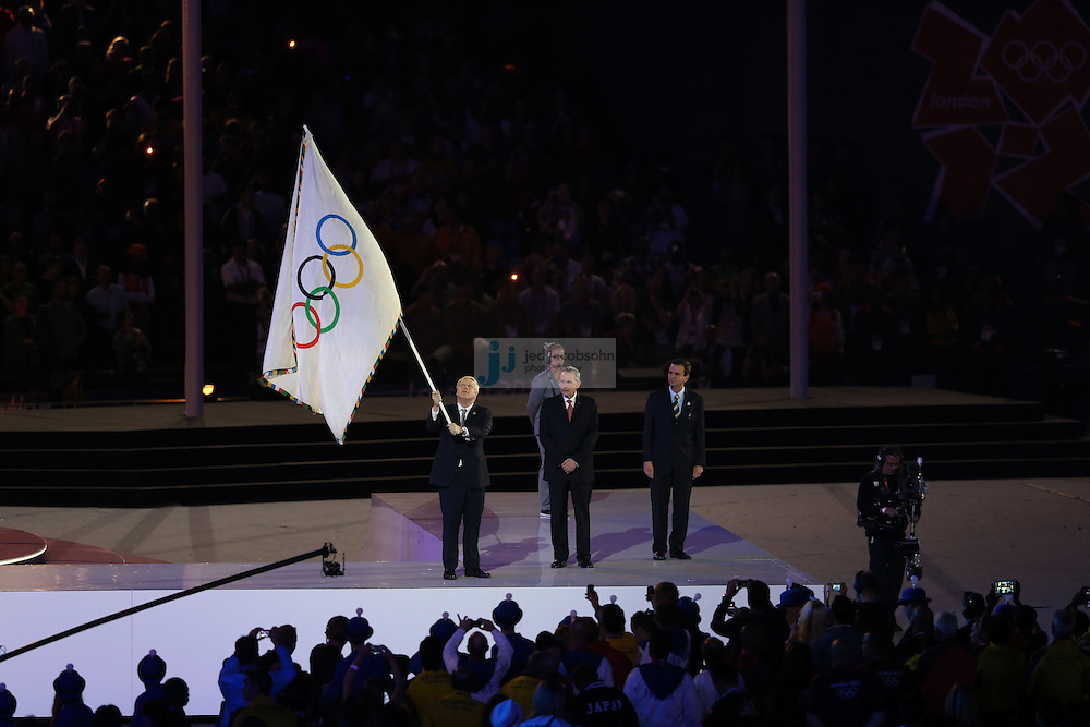 The Olympic Flag is displayed by IOC president Jacques Rogge during Closing Ceremonies during day 16 of the London Olympic Games in London, England, United Kingdom on August 12, 2012..(Jed Jacobsohn/for The New York Times)..