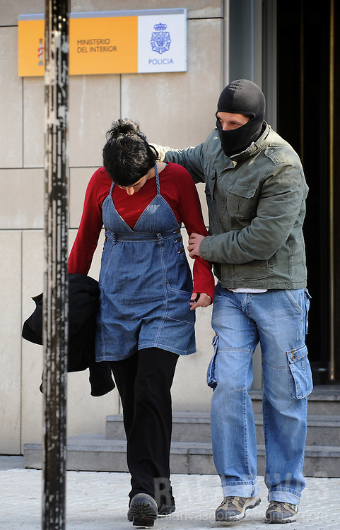 An unidentified suspect of being a member of pro-independence young Basque association SEGI leaves the Spanish National Police headquarters after her arrest, on November 24, 2009, in the northern Spanish Basque city of San Sebastian. 36 people were arrested by Spanish National Police during an anti-terrorist operation, in the Basque Country and Navarra, ordered by Spanish judge Grande Marlaska. PHOTO/Rafa Rivas