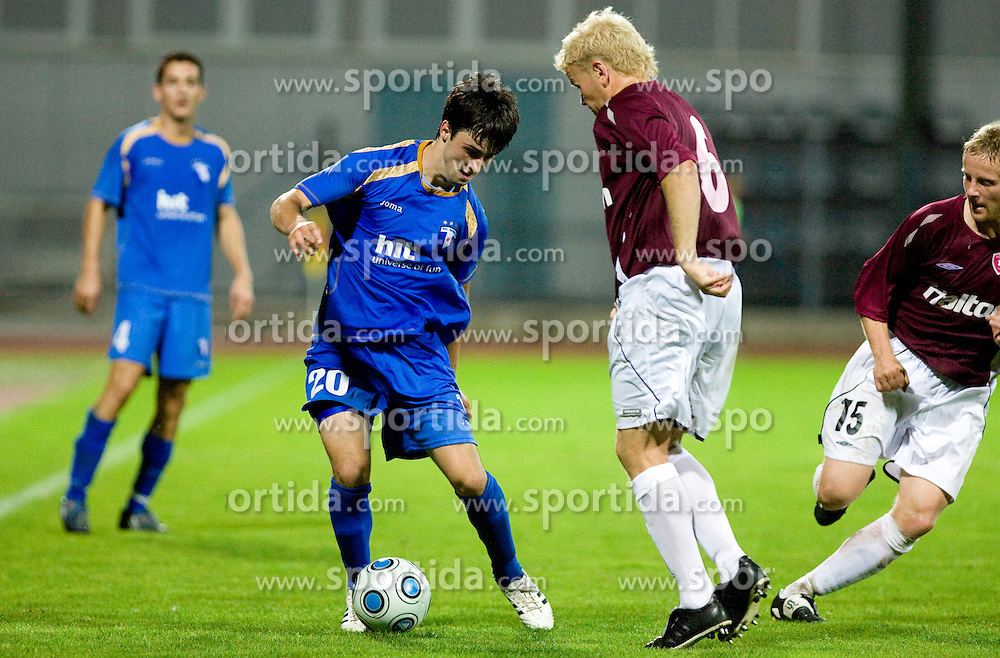 Goran Galesic of Gorica vs Kalle Eerola at 1st football match of 2nd preliminary Round of UEFA Europe League between ND Gorica and FC Lahti, on July 16 2009, in Nova Gorica, Slovenia. (Photo by Vid Ponikvar / Sportida)